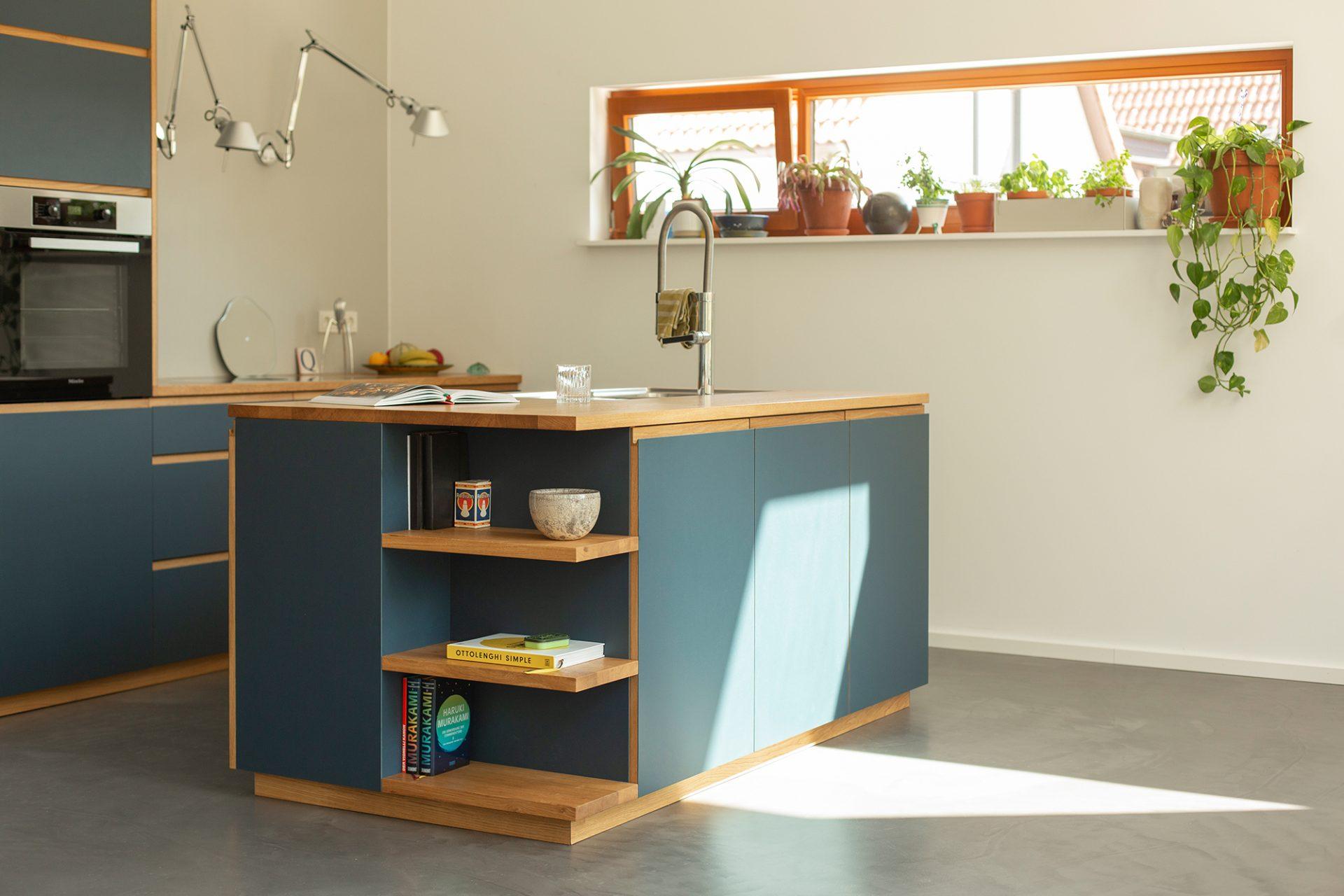 blue linoleum kitchen with oak